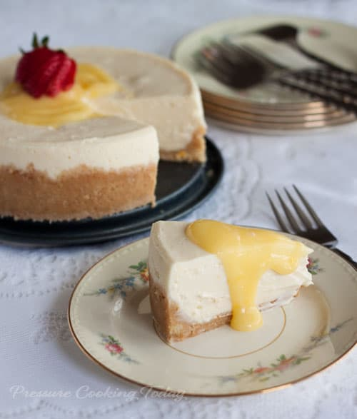 "A rich, creamy Meyer lemon cheesecake ""baked"" in the pressure cooker in just 15 minutes. Top it with a little tart lemon curd to add a little sunshine to your day."