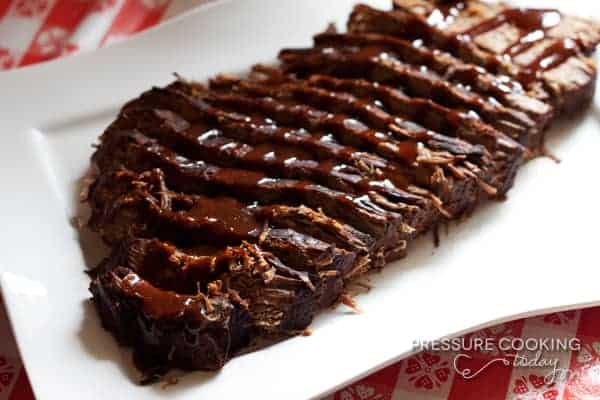 beef brisket with BBQ sauce drizzled over