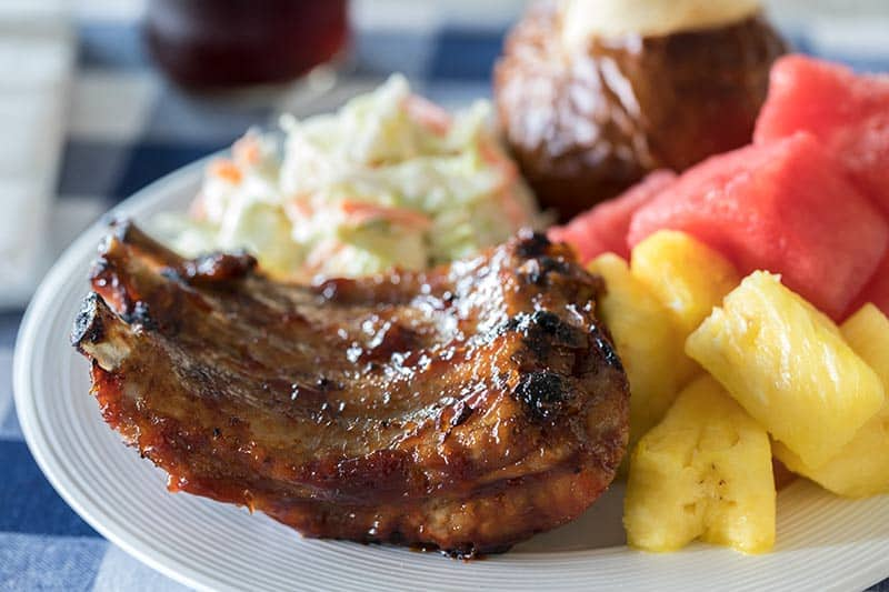Pressure Cooker BBQ Baby Back Ribs cooked in your pressure cooker or Instant Pot till they're tender & juicy, finished on the grill so the BBQ sauce caramelizes and gets sticky on the grill.
