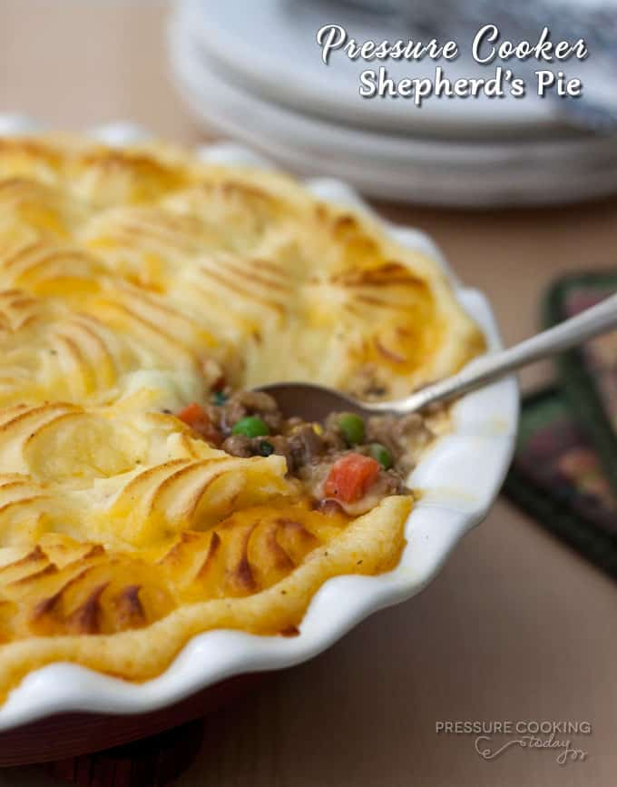 Shepherd's Pie Recipe from Pressure Cooking Today - Creamy, cheesy mashed potatoes swirled on top of a rich, flavorful ground lamb and vegetable stew.