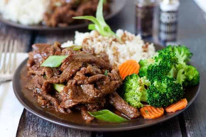 mongolian beef with broccoli, rice, and carrots