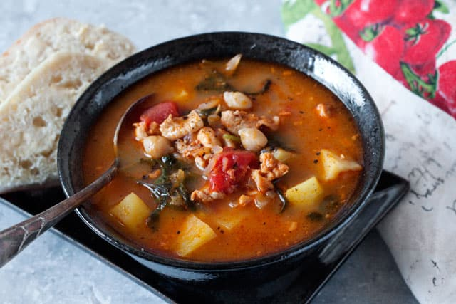 Pressure Cooker Chorizo, Chicken and Kale Soup loaded with good for you ingredients, garbanzo beans, tomatoes, and kale.