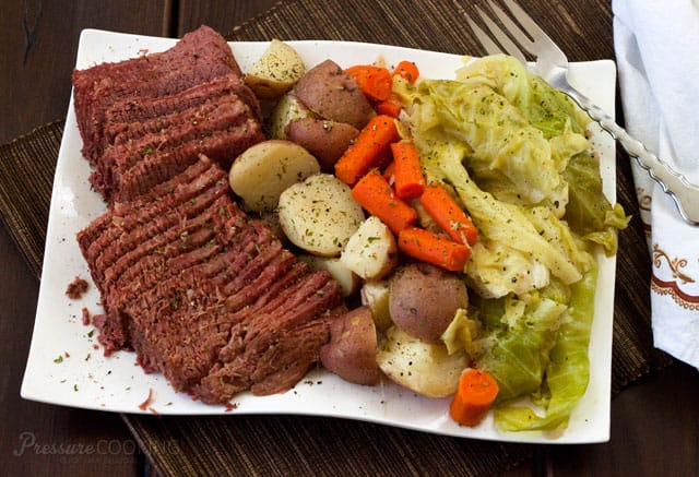 plate of corned beef, cabbage, carrots, and potatoes, all cooked in an electric pressure cooker