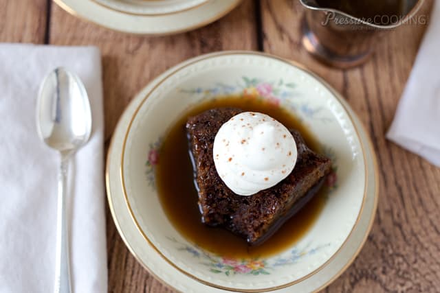 Steamed Carrot Pudding Cake with a spiced rum sauce and whipped cream.