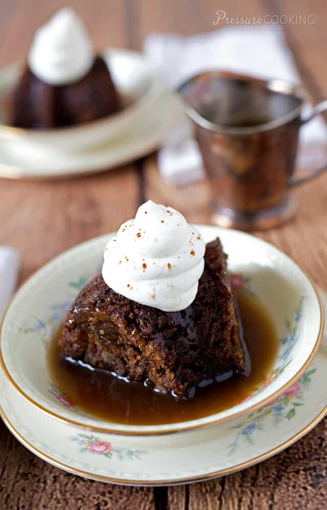A moist, tender British style steamed pudding rich with warm spices and served with a buttery spiced rum sauce.