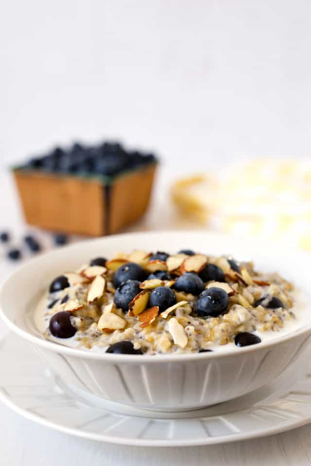 My Lemon Blueberry Steel Cut Oats are creamy, lightly sweet, flavored with lemon, studded with blueberries and chia seeds, and topped with sliced almonds.
