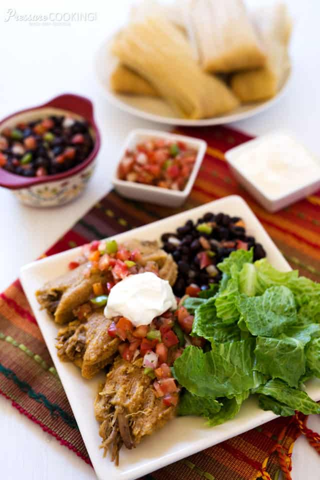 Pressure Cooker Pork Tamales made with masa that's been combined with the flavorful cooking liquid from the spicy, tender pressure cooked pork shoulder.