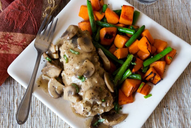 Pressure Cooker Mini Cheese Stuffed Turkey Meatloaves filled with a creamy garlic and herb cheese and smothered with a flavorful mushroom gravy.
