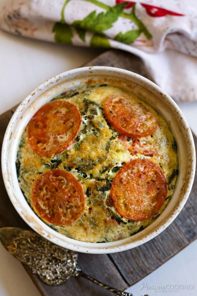overhead image of a crustless quiche with spinach and tomatoes, made in a pressure cooker