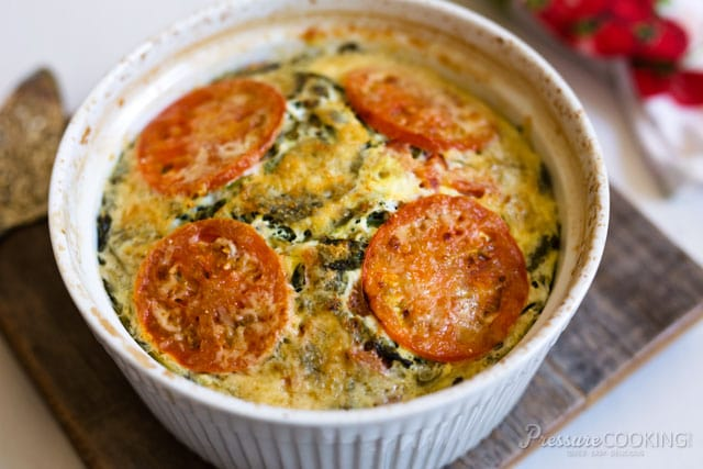 A Pressure Cooker Crustless Tomato Spinach Quiche loaded with good for you veggies.