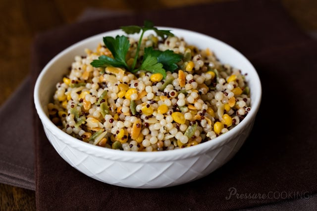 This Pressure Cooker Israeli Couscous is a quick and easy side dish that's a perfect addition to whatever meat you're cooking. Or, mix in some protein and veggies for a simple one dish meal.