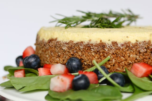 Pressure Cooker Blue Cheese Cheesecake surrounded by fresh spinach salad with strawberries and blueberries