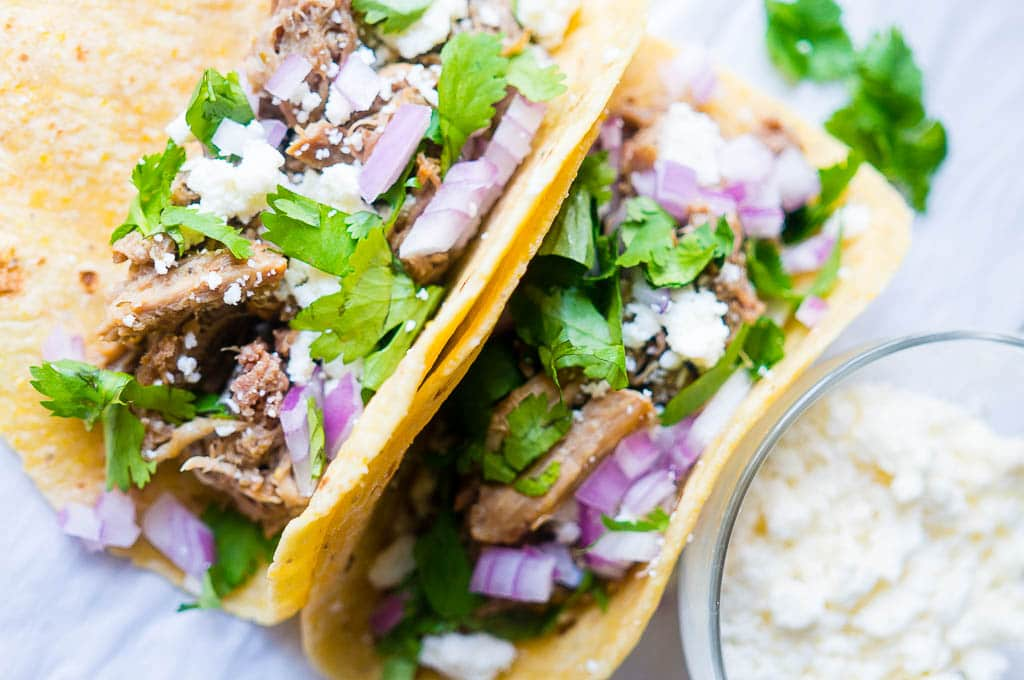 Pressure Cooker Green Chile Pork Carnitas. Moist, flavor-packed, and fall apart in your mouth tender, these green chili pork tacos are the perfect solution for a speedy family friendly dinner!