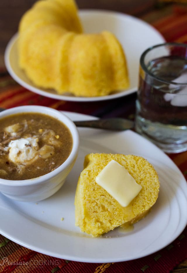 Pressure Cooker Cornbread on a plate next to a bowl of chili