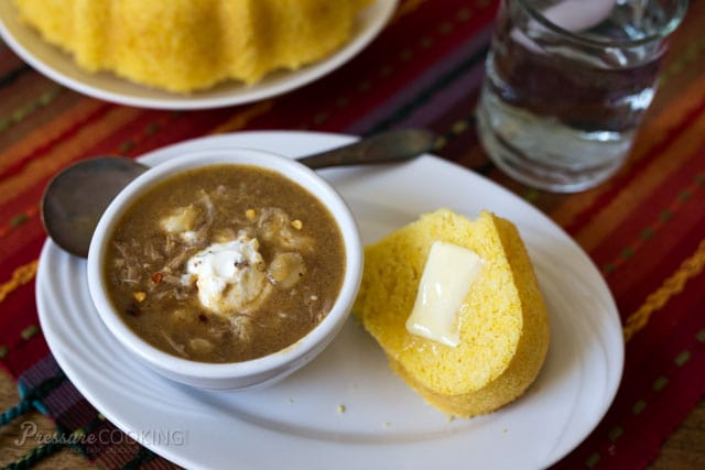 a bowl of chicken posole and a slice of cornbread with butter. Both made in an Instant Pot