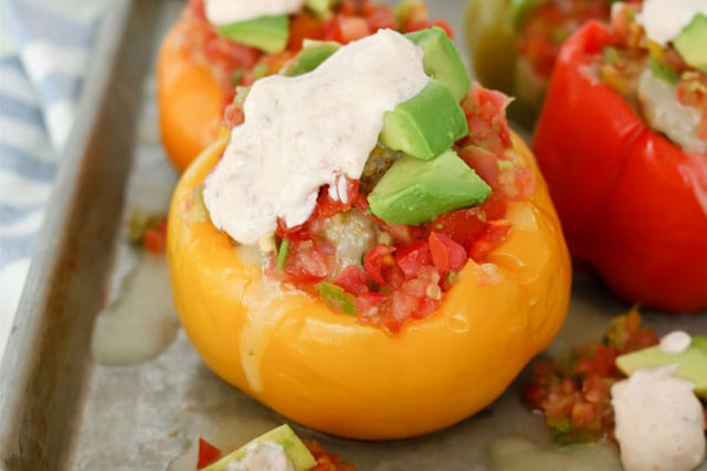 close up image of Mexican Stuffed Bell Peppers with Chipotle Lime Sauce that were made in an electric pressure cooker (Instant Pot)