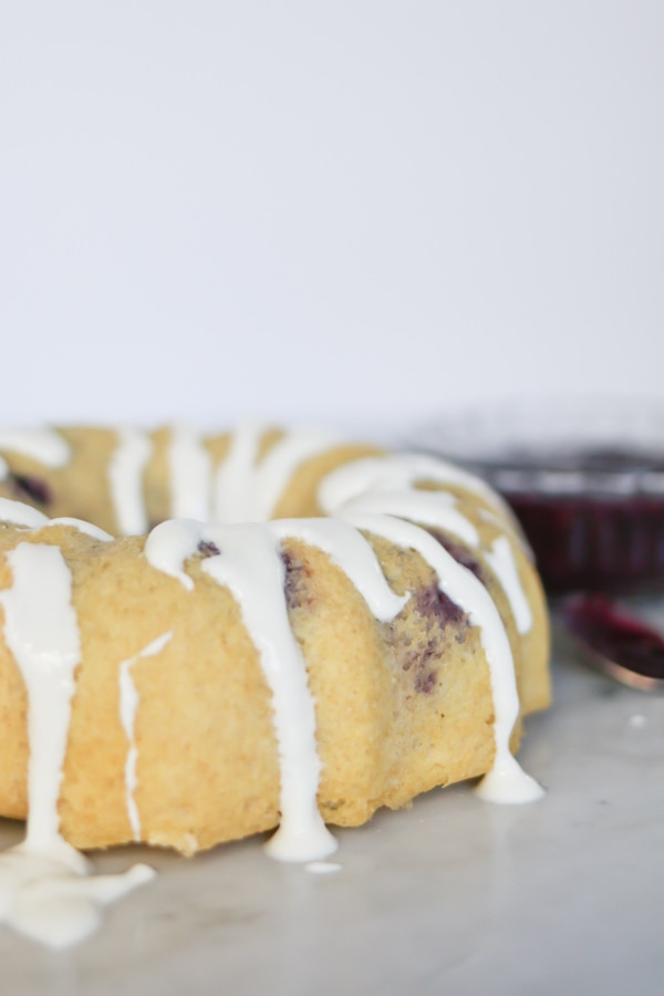 Pressure Cooker Berries and Cream Breakfast Cake drizzled with sweet icing