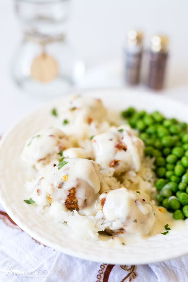 Tender, cheesy Pressure Cooker Chicken Parmesan Meatballs in a rich, creamy ranch sauce. A quick and easy meal that's loaded with flavor.
