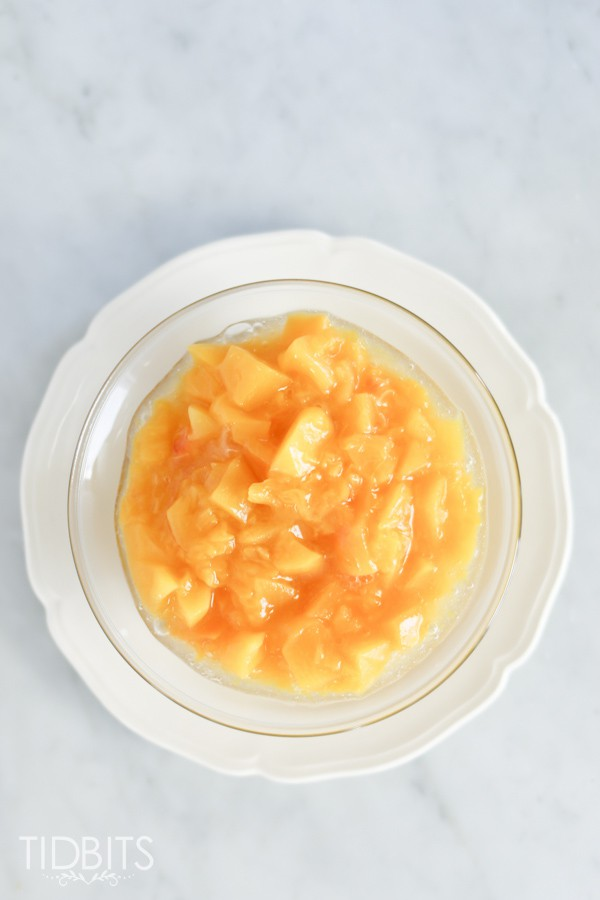 white bowl of Peach Compote made in a pressure cooker