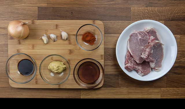 ingredients on a wooden cutting board to make Pressure Cooker Maple Dijon Mustard Pork Chops