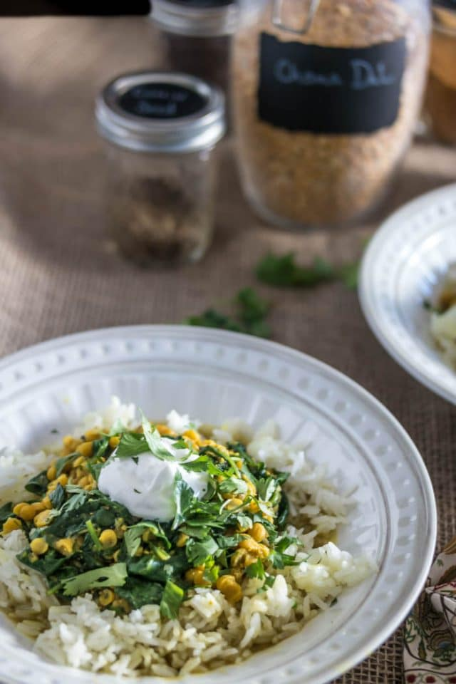 white bowl of Pressure Cooker Dal With Spinach served over white rice