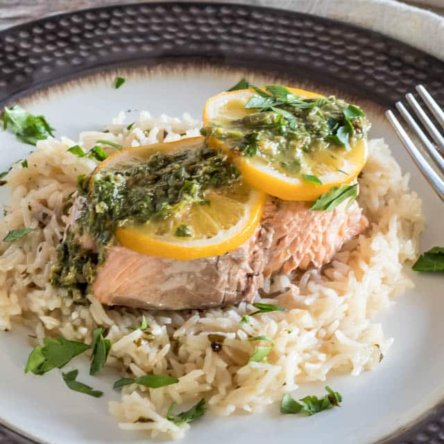 Pressure Cooker Salmon and Rice topped with capers and chimichurri sauce