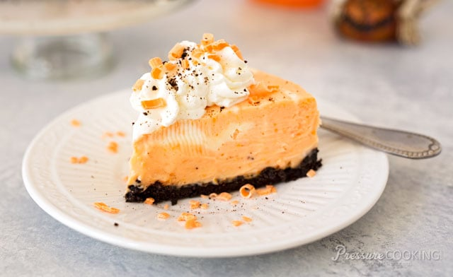 Orange Marble Cheesecake with an Oreo cookie crust is a luscious cheesecake dessert. The perfect pressure cooker cheesecake recipe for a Halloween party.