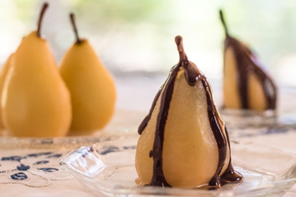 cinnamon poached pears with chocolate sauce made in a pressure cooker