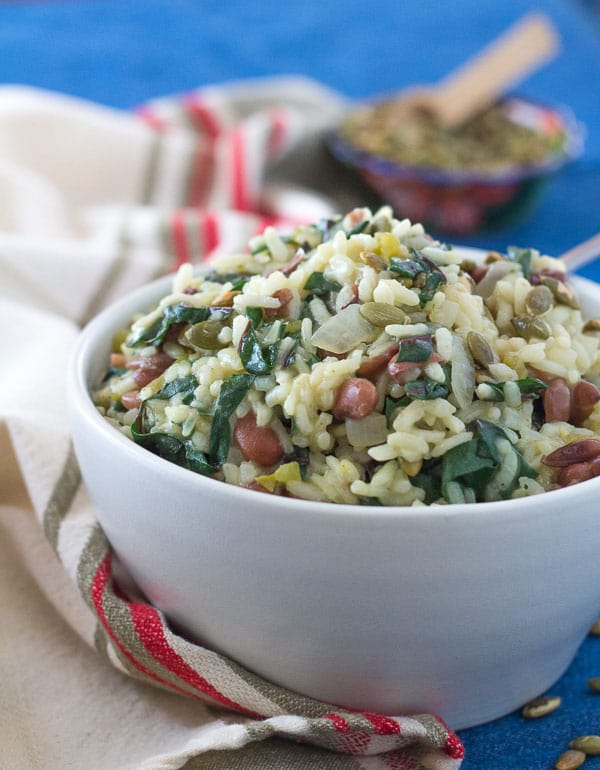 close up photo of Southwest Pinto Bean and Chard Risotto in a white bowl