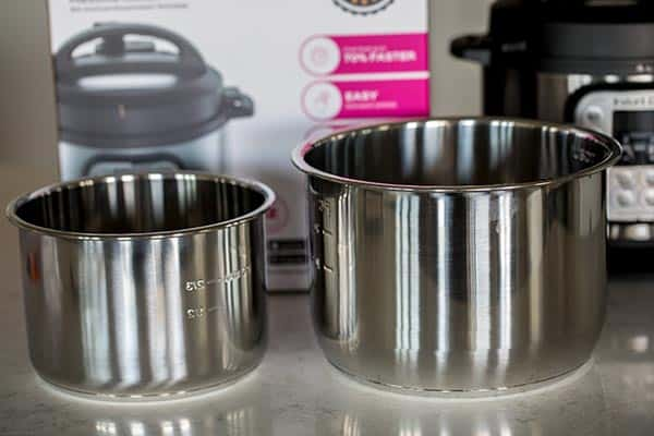 Cooking pot of the Mini side by side with the Instant Pot Duo cooking pot.