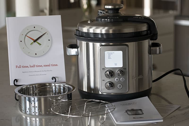 Breville The Fast Slow Pro Pressure Cooker comes with a stainless steel rack and steamer basket.