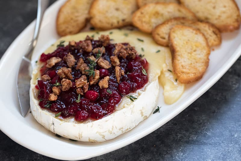 platter of Pressure Cooker Cranberry Pecan Baked Brie and crackers