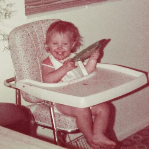Jennifer eating as a baby