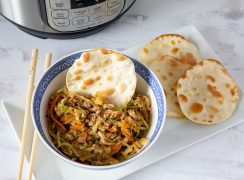 Instant Pot Egg Roll Bowls, dished up in a small bowl and ready to serve with wonton wrappers
