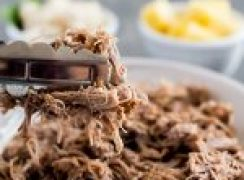 Instant Pot / Pressure Cooker Kalua Pork recipe, plated and ready to serve with pineapple and white rice