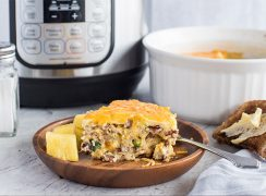 A slice of Pressure Cooker Meat Lovers Crustless Quiche, plated with an Instant Pot in the background