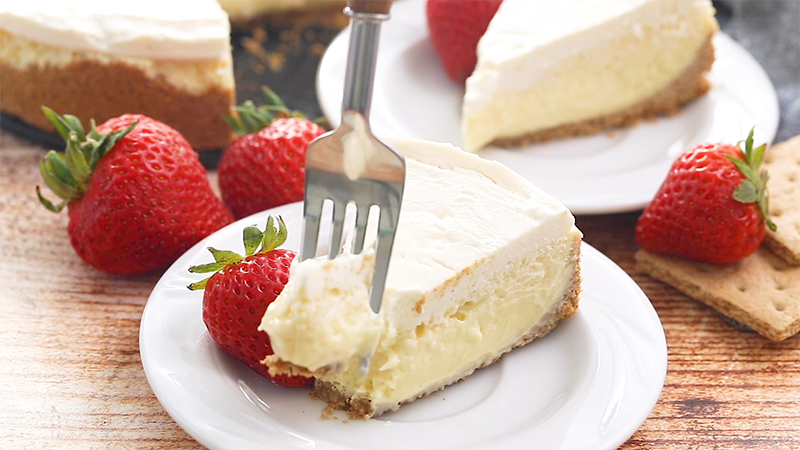 A slice of vanilla sour cream topped cheesecake aka Hollywood Two-Toned Cheesecake