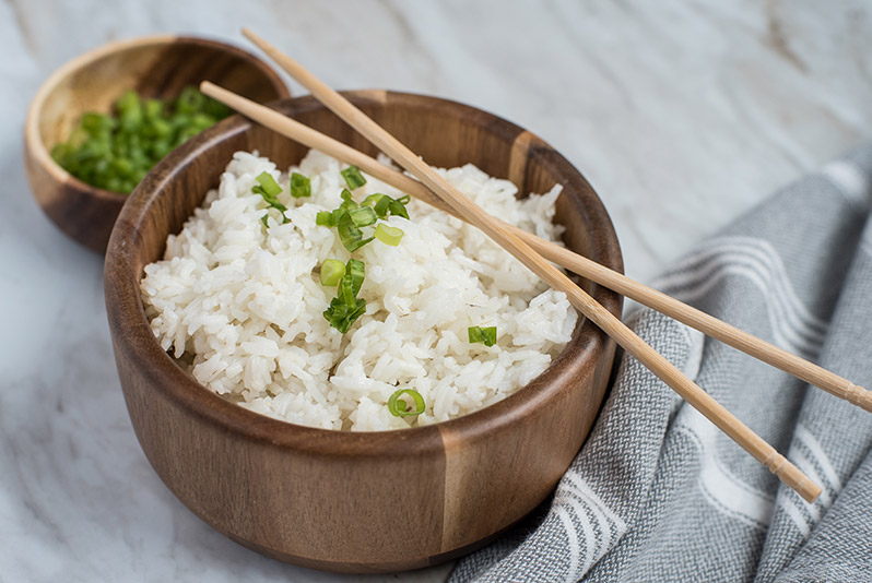 Instant Pot / Pressure Cooker White Rice prepared, garnished with green onions and chopsticks