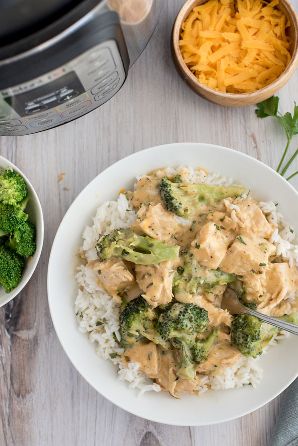 An overhead shot of InstaPot Cheesy Chicken and Broccoli with a bowl of broccoli and cheese and an Instant Pot featured in the upper corners.
