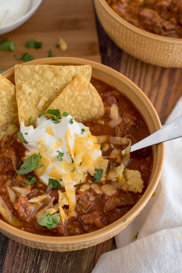Beef and Bean Instant Pot Chili with sour cream, cheddar cheese, cilantro, and tortilla chips
