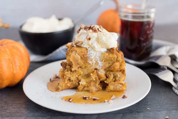 Profile image of Instant Pot / Pressure Cooker Pumpkin Spice Baked French Toast with whipped cream, maple syrup, and pecans on top.