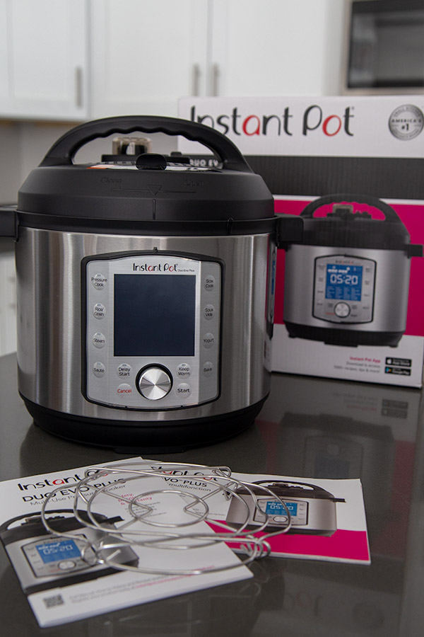 Instant Pot Evo pressure cooker with user guide and trivet