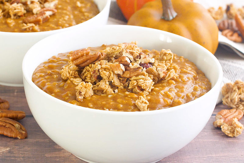 Pumpkin Spice Instant Pot Steel Cut Oats in a white bowl, topped with pecans and granola