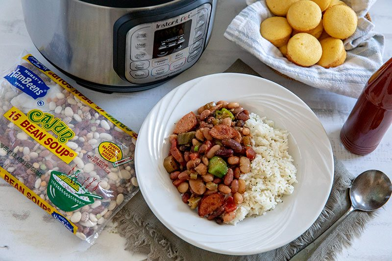 Instant Pot Cajun 15 Bean Soup with Rice and Sausage with corn muffins and hot sauce