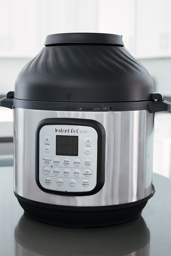 Instant Pot Duo Crisp with Air Fryer lid placed on top.