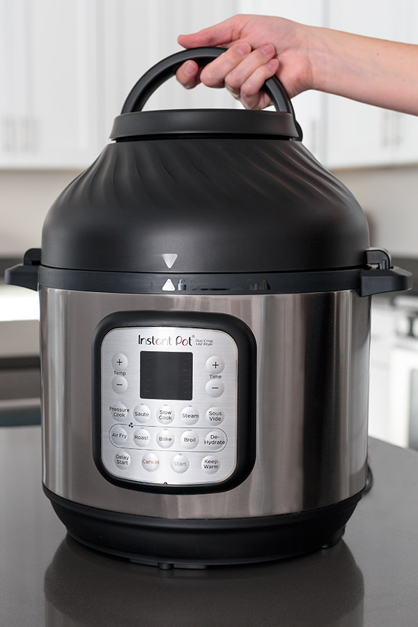 Instant Pot Duo Crisp from the front placing the air fryer lid.