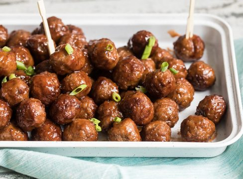 InstaPot grape jelly bbq meat balls on a platter and ready to serve for a party.