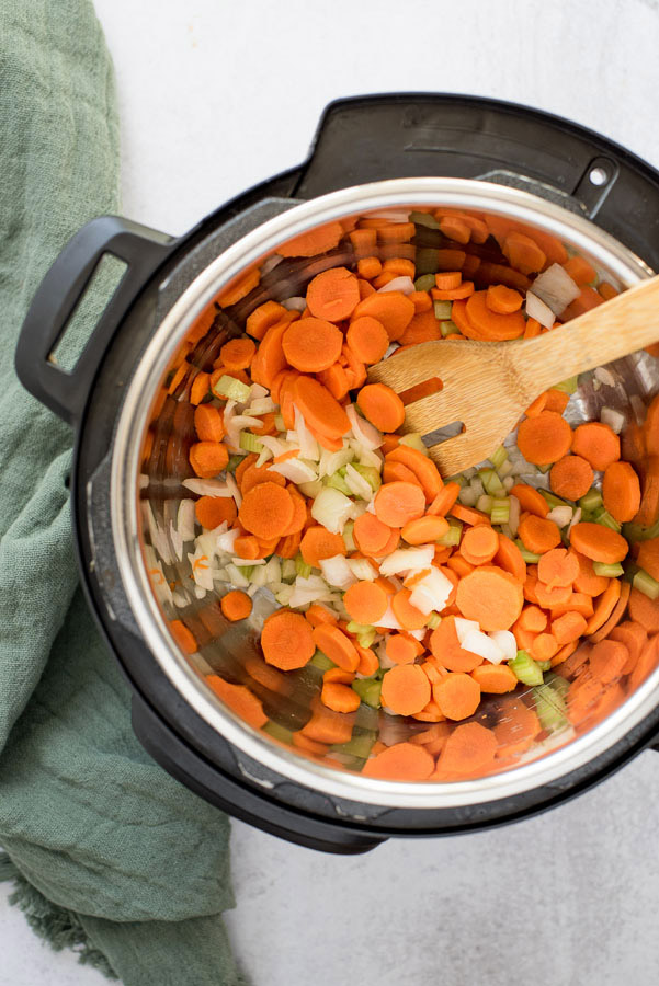 Instant pot sauteing carrots, celery, and onion when making pressure cooker chicken noodle soup.