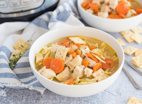 Pressure cooker chicken noodle soup made from scratch in an Instant Pot shown served in a bowl.