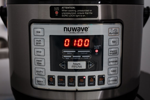 NuWave Pressure Cooker control pannel on the keep warm setting.